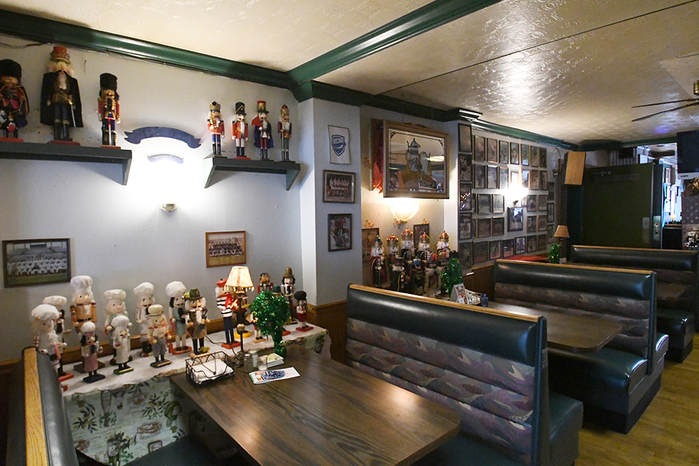 Dining room booths at Tiny's showing sports memorabilia on walls and part of nutcracker collection