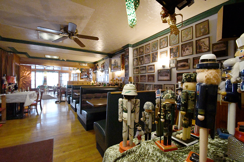 Dining room view with sports photos on walls and military themed nutcrackers on shelves