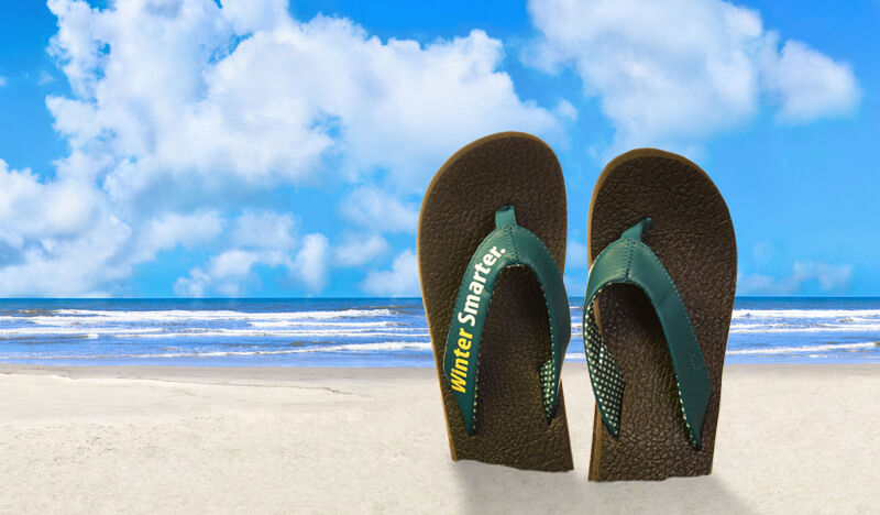 "Tropical beach scene, trip paid for with financing, flip flops stuck in sand say ""Winter Smarter"""