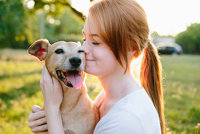 redhead teenage girl and her dog portrait